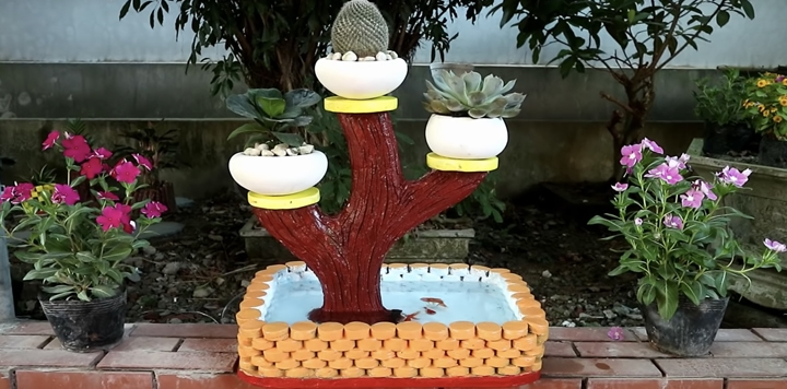 Цветочки и грибочки из цемента порядком поднадоели? Нетривиальная идея декора для дачи