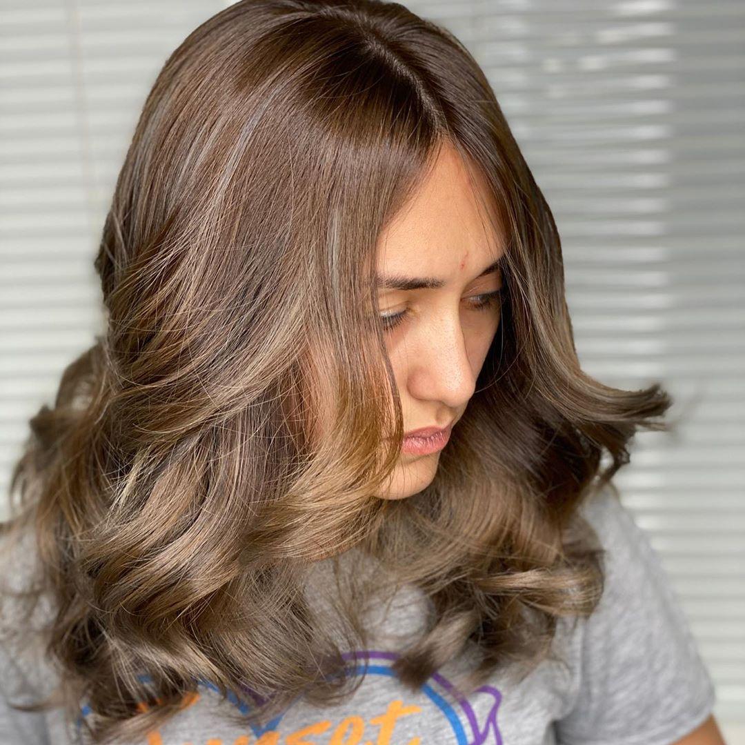 Стрижки после 50 лет на кудрявые волосы 2019-2020 фото 8
